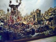 182 - Napoli- certosa-san-martino-presepe di Cuciniello. E' il piu' celebre presepe mai costruito a Napoli , oggi conservato nel museo di San Martino. Il celebre presepe, collocato in uno degli ambienti delle cucine dei monaci, appositamente ideato come l'antro di una grotta artificiale, si articola nei consueti elementi essenziali: la Natività, disposta al centro, entro un tempio dirupato e sormontata da una gloria di angeli, Il presepe, punto di riferimento obbligato per gli allestimenti posteriori. Si inaugurava pubblicamente il 28 dicembre 1879