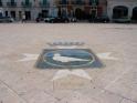 9 - Fasano - Piazza Ciaia. In marmo al centro del pavimento della piazza lo stemma della città.