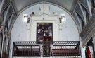 57 -Ostuni, interno del Santuario diSant'Oronzo, Dettagli dell'altare maggiore, dedicato al Santo, è annunciato da due scalinate in pietra situate ai lati della grotta. Due pilastri sorreggono il piano mensa dal quale si elevano due ripiani riccamente scolpiti a motivi geometrici e foglie di acanto; al centro si apre un tabernacolo di stile neoclassico. Sull'altare era ubicata la statua di S. Oronzo a grandezza naturale. Sul muro è dipinta la figura del Santo che benedice la città di Ostuni.