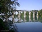 26 -Gorizia. Il fiume Isonzo e sullo sfondo il ponte ferroviario dei primi del Novecento