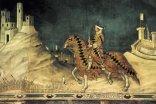 """14 -Sempre Simone Martini realizzò sulla parete opposta della Maestà, l'affresco """"Guidoriccio da Fogliano all'assedio di Montemassi"""", allegoria dell'espansione di Siena."""